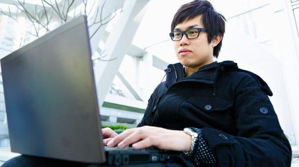 chineseman.laptop.shutterstock