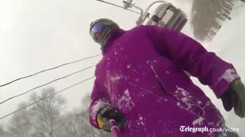 selfie stick snowboarder