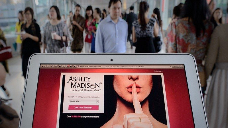 TO GO WITH AFP STORY LIFESTYLE-HONG KONG-INTERNET-SEX, FOCUS by Aaron Tam This photo illustration taken on August 20, 2013 shows the homepage of the Ashley Madison dating website displayed on a laptop in Hong Kong. The founder of a dating service promoting adultery is setting his sights on China's cheating hearts after a controversial launch in Hong Kong. AFP PHOTO / Philippe Lopez (Photo credit should read PHILIPPE LOPEZ/AFP/Getty Images)