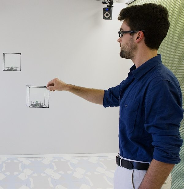 Researcher interacts with ShapeDrone